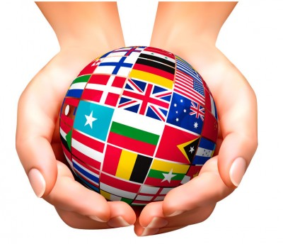 23640368 - flags of the world in globe and hands. vector illustration.